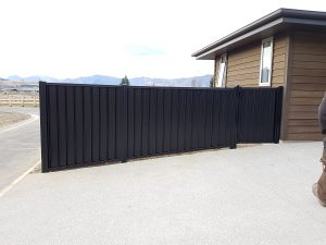 colour panel fence with a gate