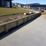 Retaining wall to driveway